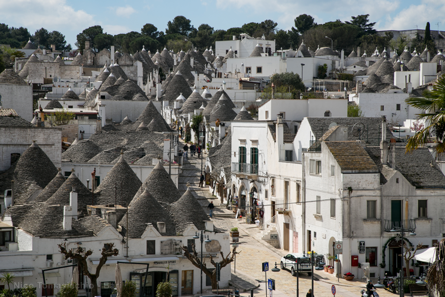 Alberobello   30 minutes by car: A fairytale UNESCO World Heritage town made of 1500 Trulli (typical Apulian conical stone huts). It is considered a unique and enchanting place. Yes, it's a bit touristy. But you've never seen anything like it. It's worth a visit (about 2-3 hours tops). Cost: your share of the car or shuttle bus.