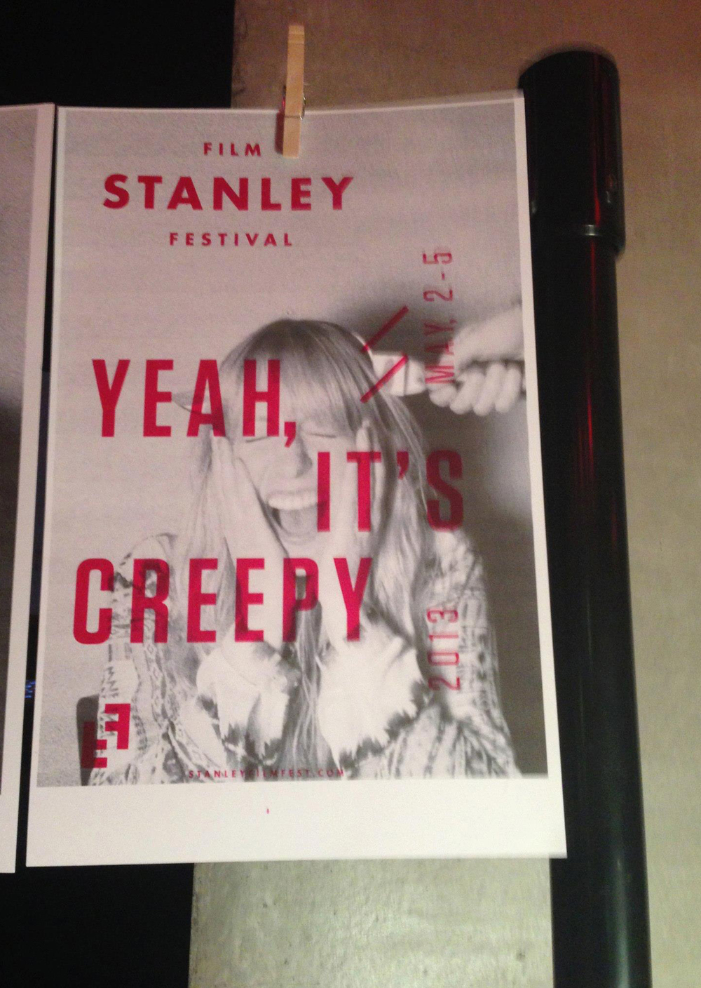A screen printed photograph hangs on a line at the Stanley Film Festival kick-off event.