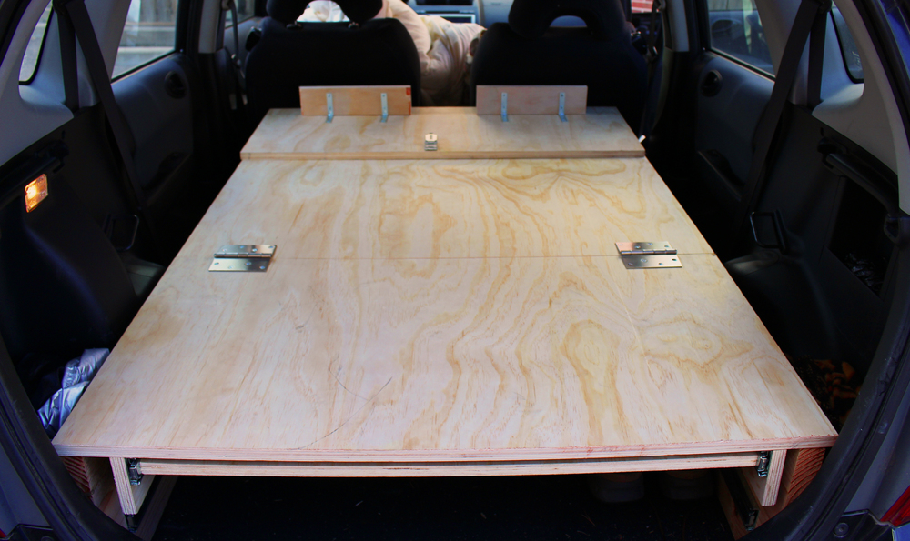 The plywood bed, built for car camping in Adam Jeffers' Honda Fit.