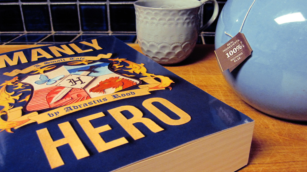 manly hero book cutting board.jpg