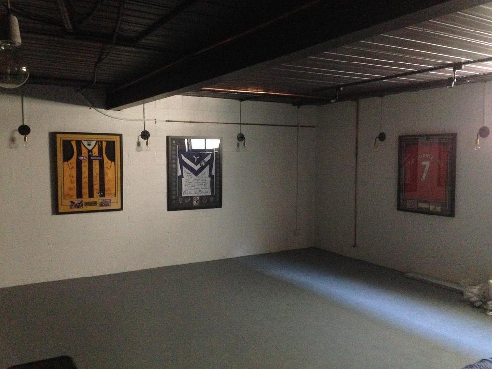 man's cave personal memorabilia 7 perfectly hung.JPG
