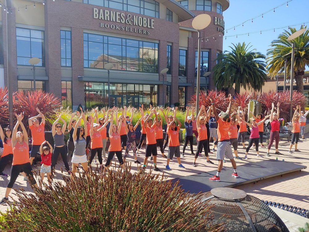 Zumba fundraiser class on October 7, 2018 in Emeryville's Bay Street Plaza.
