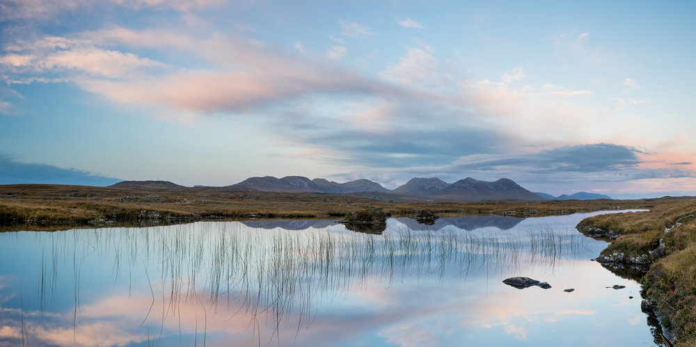 The Twelve Bens reflecting in the Connemara Bog complex at sunset