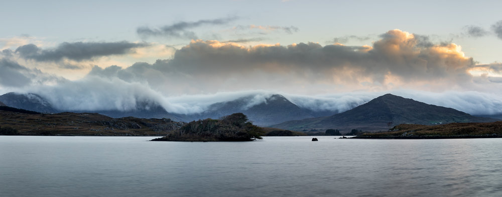 Misty sunrise over the Twelve Bens.