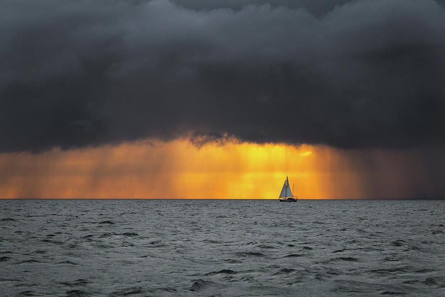 boat-sailing-into-the-storm-at-sunrise-arsen-volkov.jpg