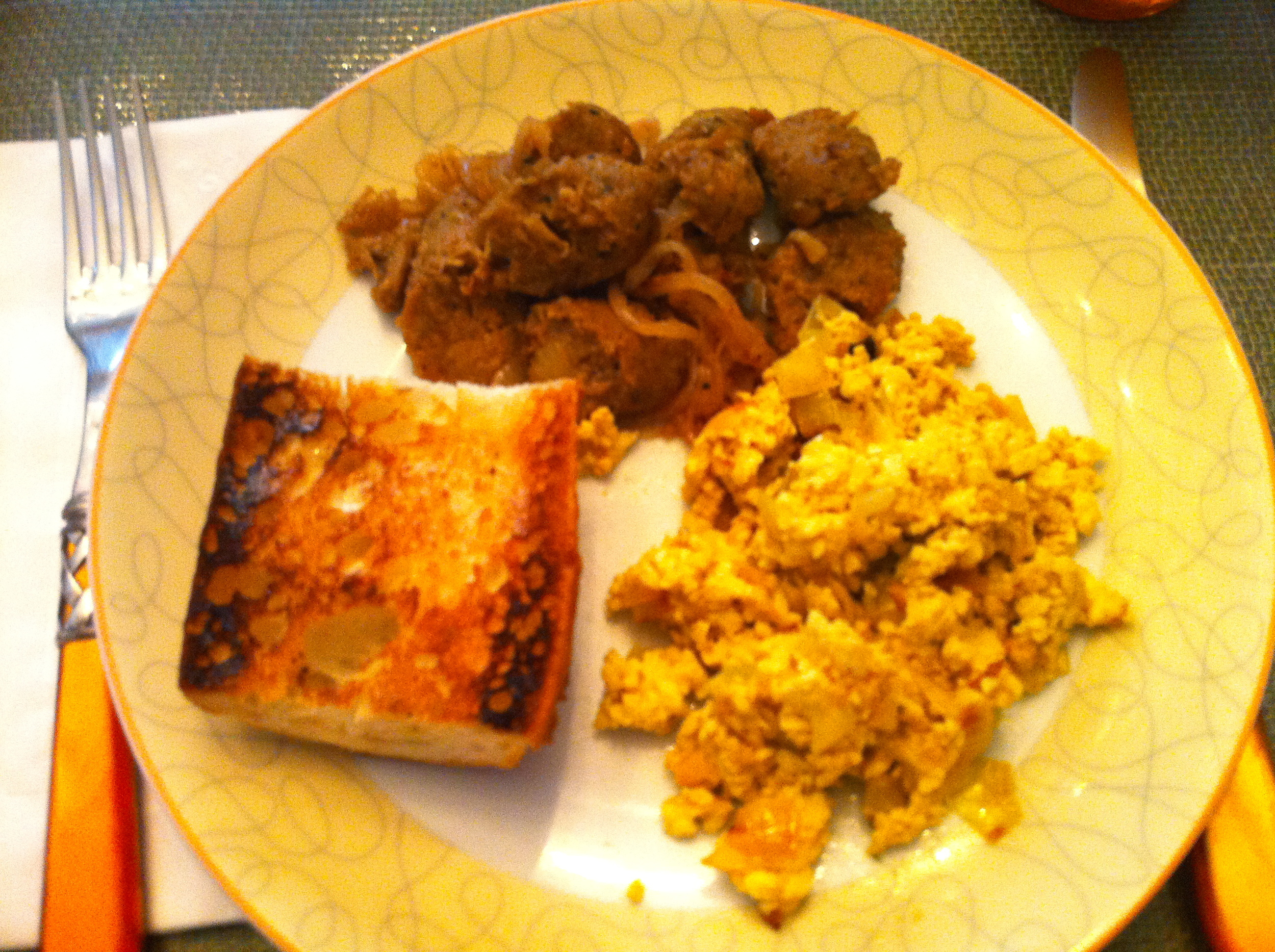 This breakfast is fully rounded and totally vegan with organic, tofu scramble, vegan sausage and onions, and toast fresh from the bakery.