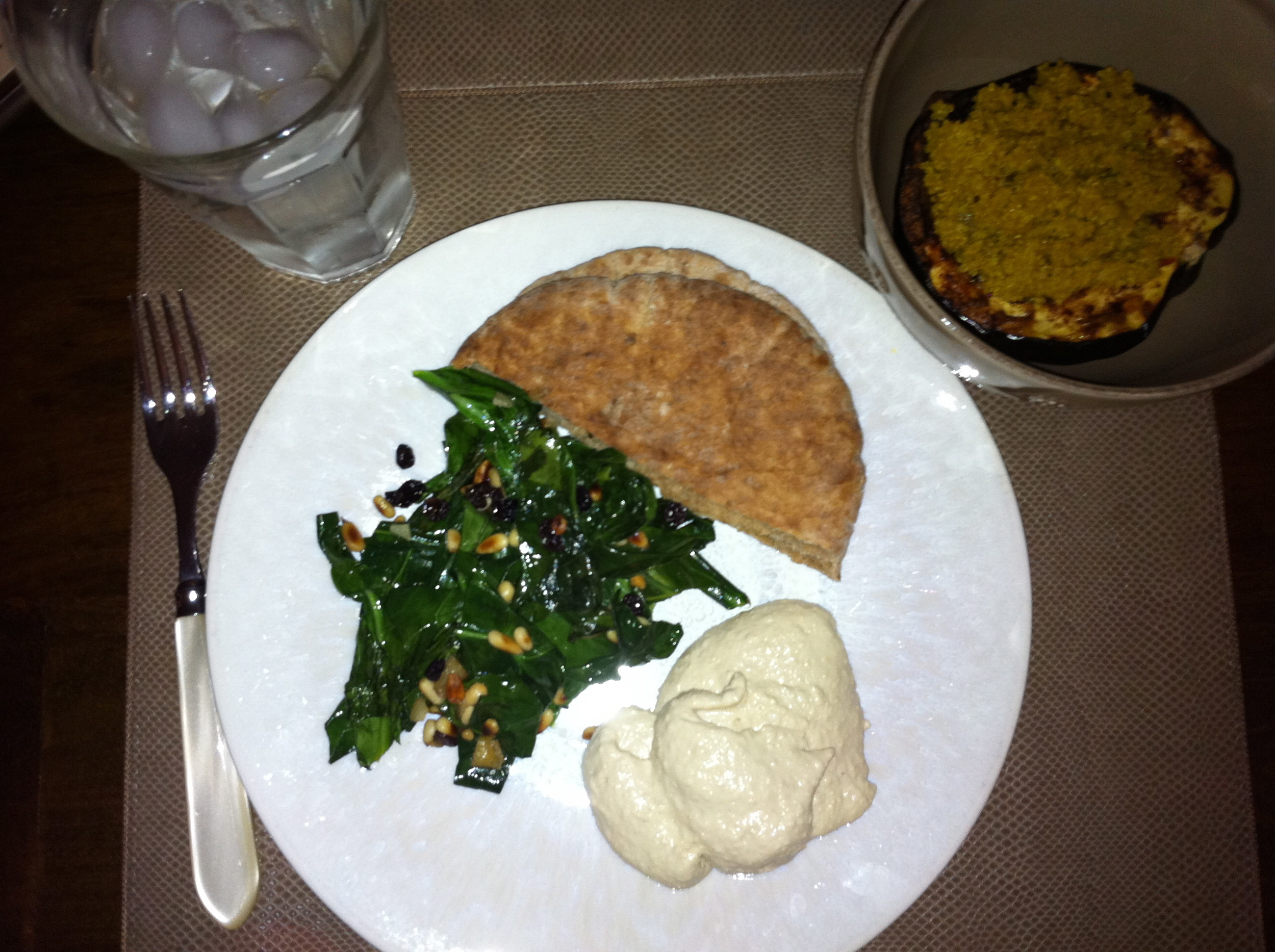 I served the quinoa and squash with hummus, whole wheat pita, and sauteed collard greens with pine nuts and currants.