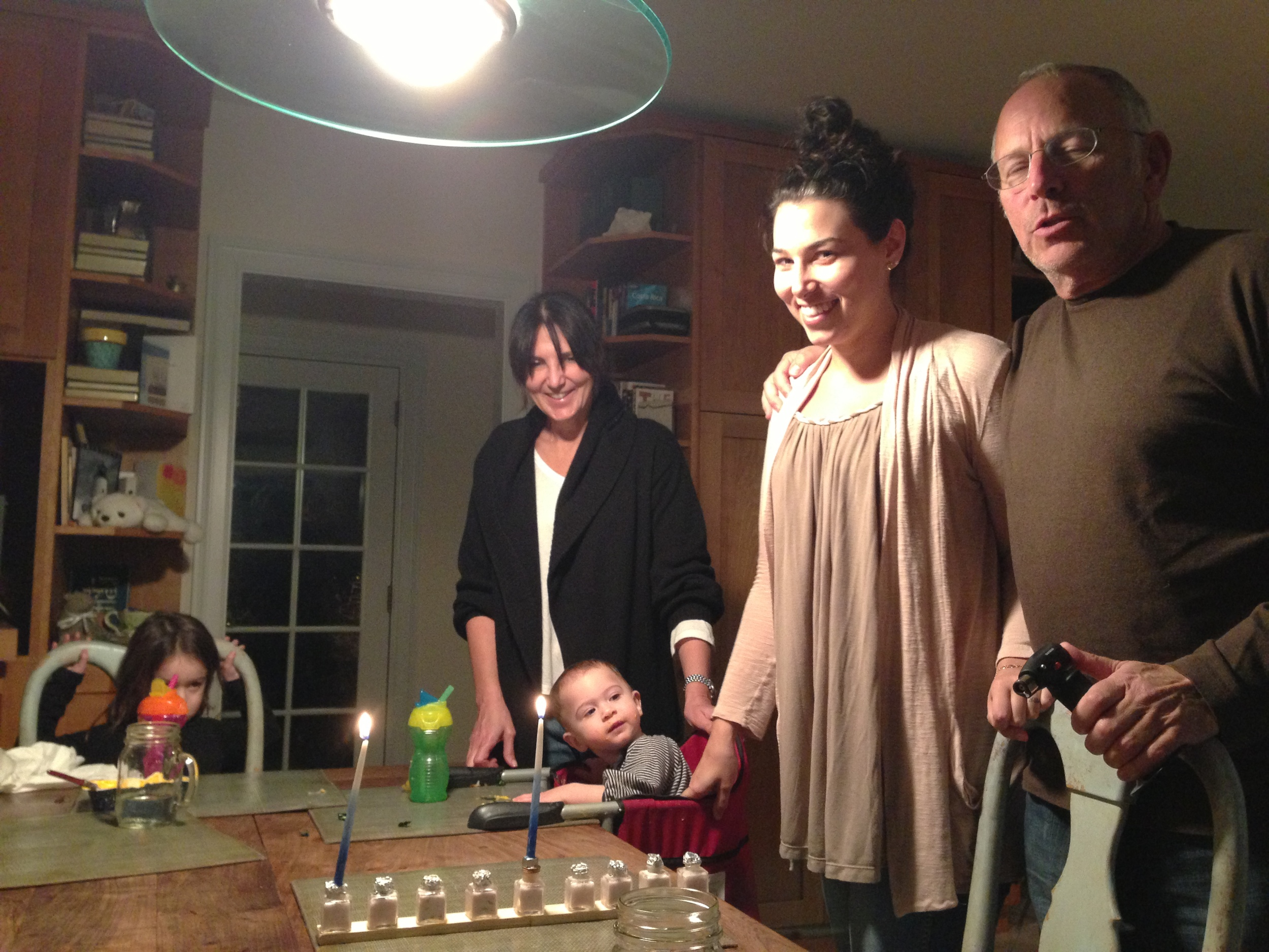 (Channukah with Liza and my Parents.)
