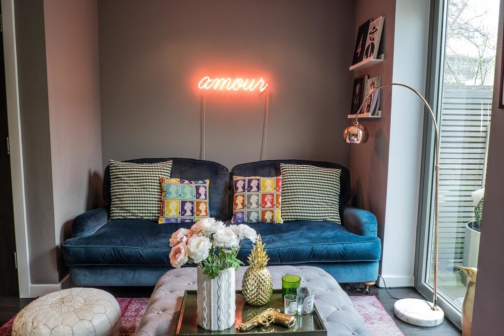 The 'amour' neon light which proudly sits in Stella + the Stars own living room