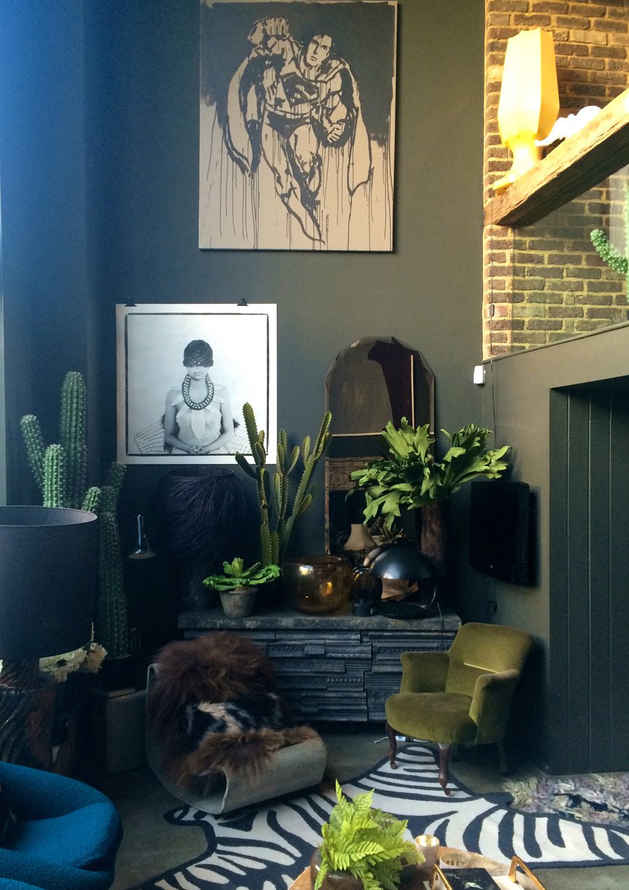 Abigail Ahern's own living room is filled with greenery, mostly faux plants and cacti. It just adds colour and drama to the space. Image Source: Abigail Ahern.