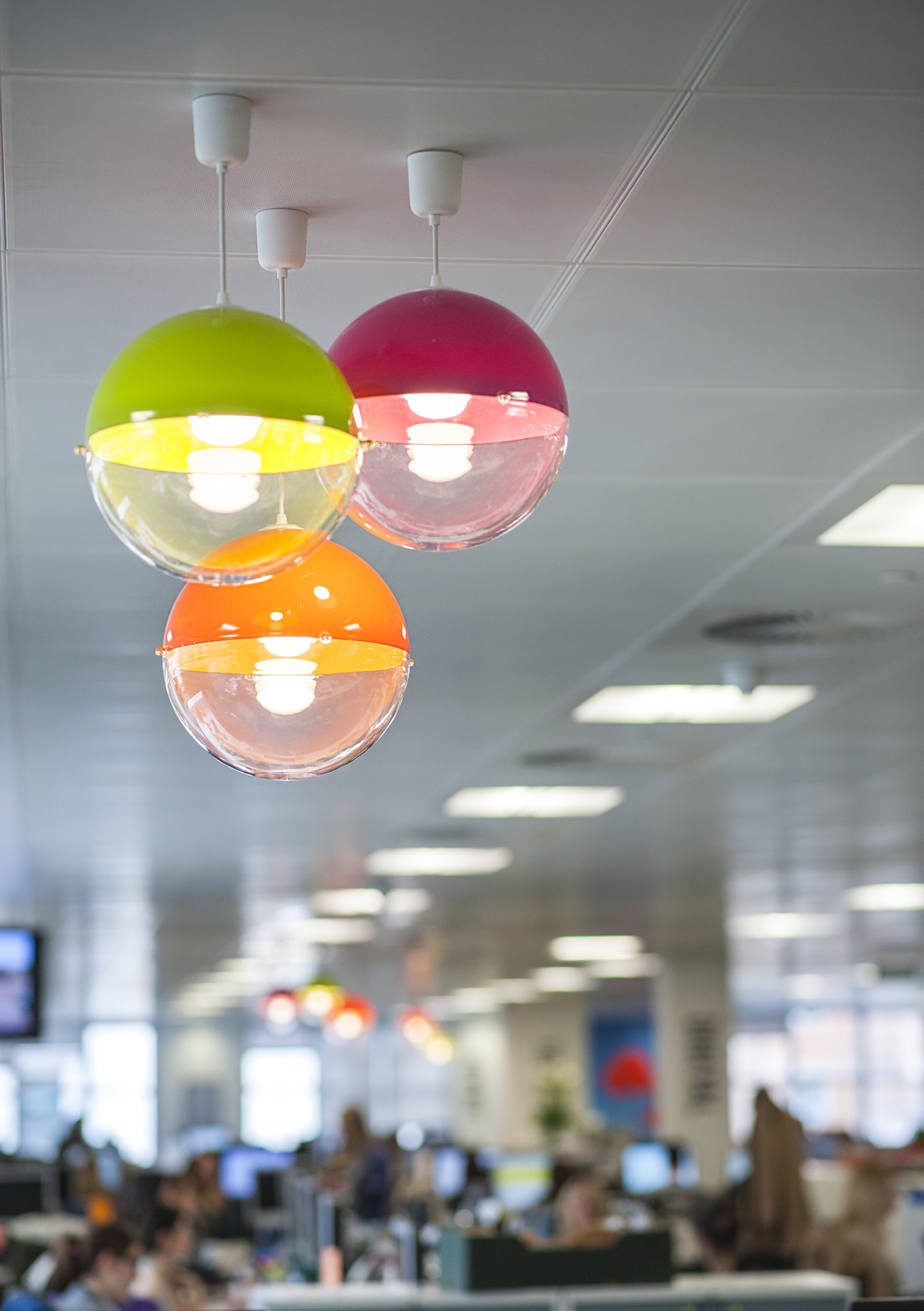 clusters of colourful lampshades dotted around the office added colour and quirk (PHOTO CREDIT: ELIZABETH ARGYLL)