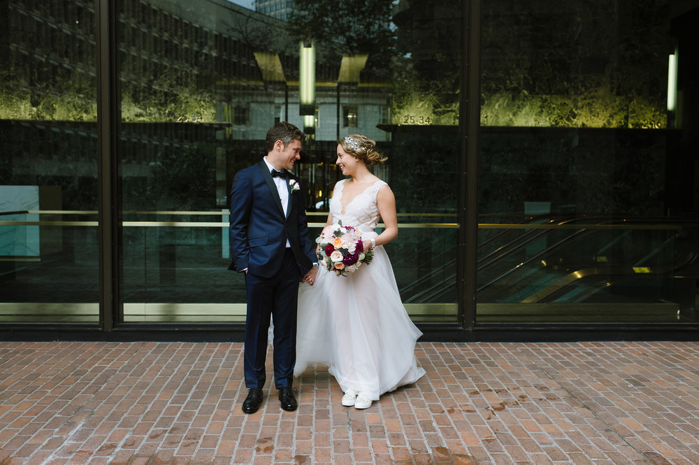 Bride and Groom smiling outside The UMass Club, Boston