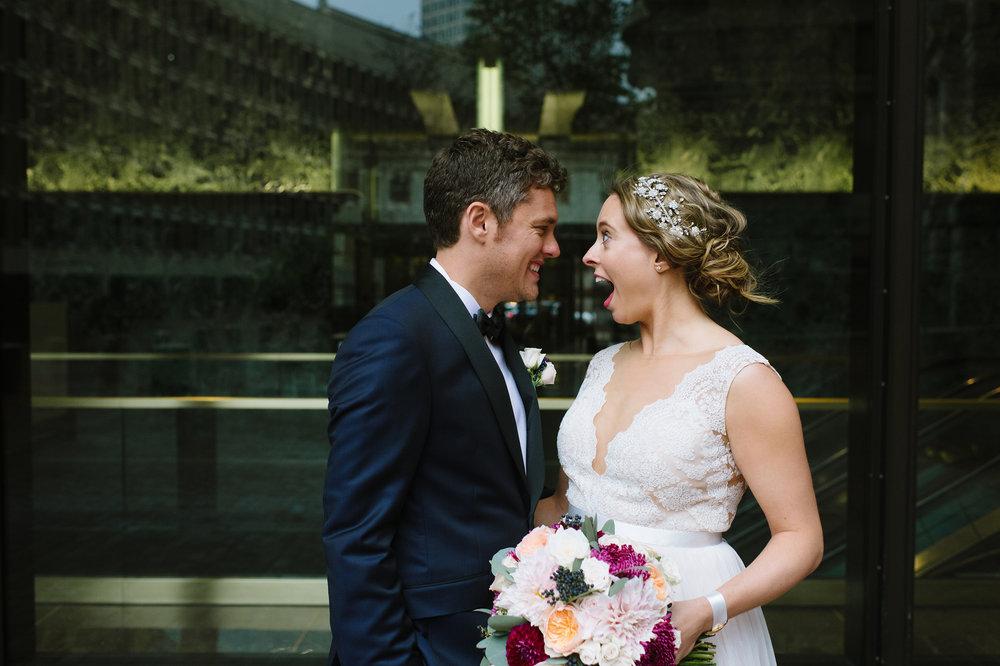 Candid wedding photo of couple smiling outside of the UMass Club,Boston