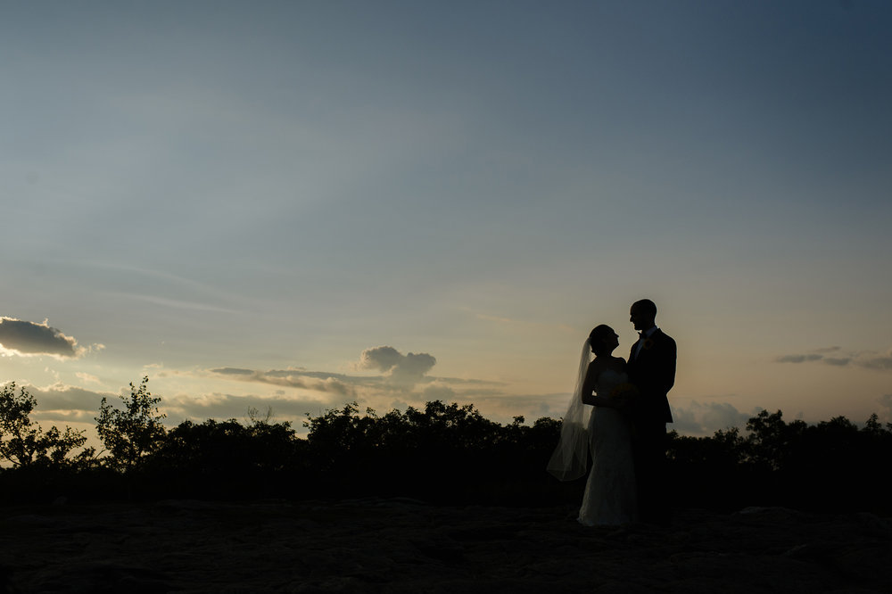Bride and Groom on top of Wachusett Mountain during sunset