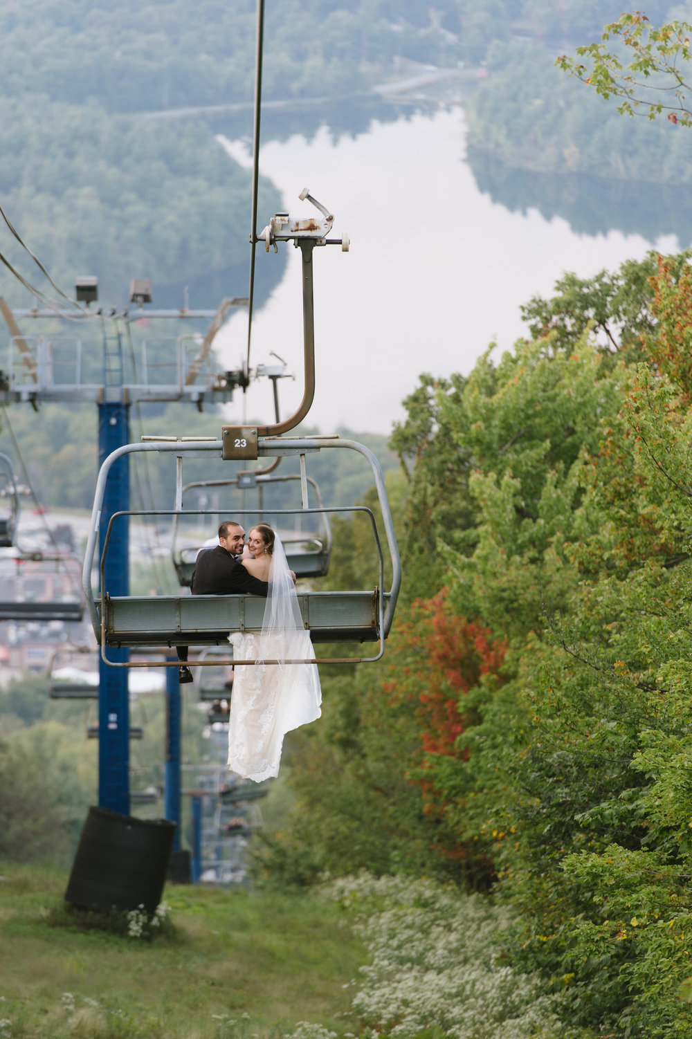 Bride and Groom ride the chairlift on their wedding day at Wachuett Mountain Ski Area