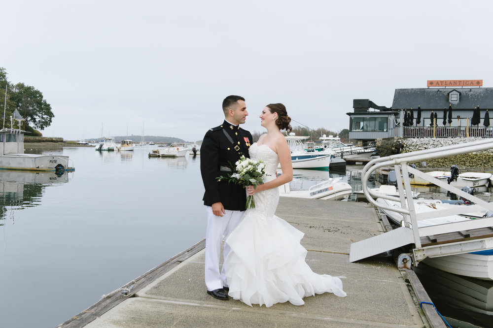 Bride and Groom standing by the dock outside The Atlantica, Cohasset on their wedding day