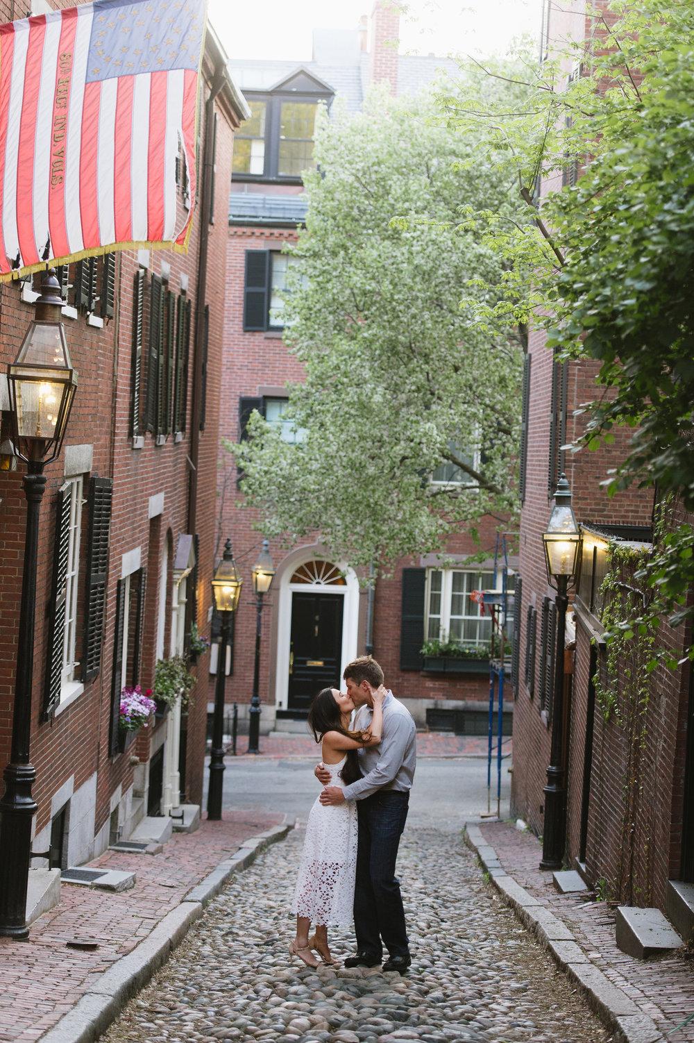 Couple kissing on Acorn Street, Boston for engagement photos