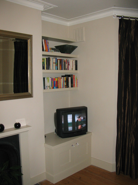 Living room cupbard with floating shelves.jpg