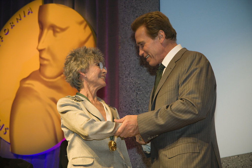 Governor Arnold Schwarzenegger congratulates Rita Moreno upon her induction into the California Museum Hall of fame.