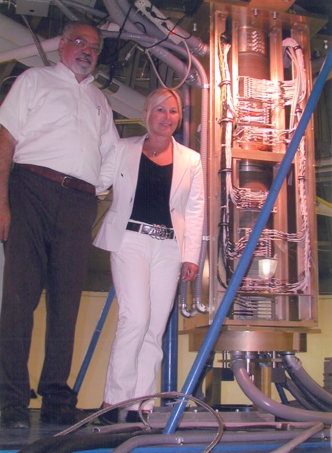 Peter Vita (Chief Engineer) & Wendy Montanaro (one of Wendon's owners) standing with a 390 circuit slip ring assembly installed at Draper Laboratories, Concord, MA, for centrifuge testing of electronic components for U.S. space and military programs.