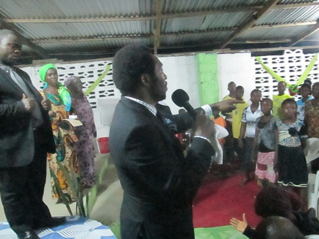 Apostle Dotun declaring the word.JPG