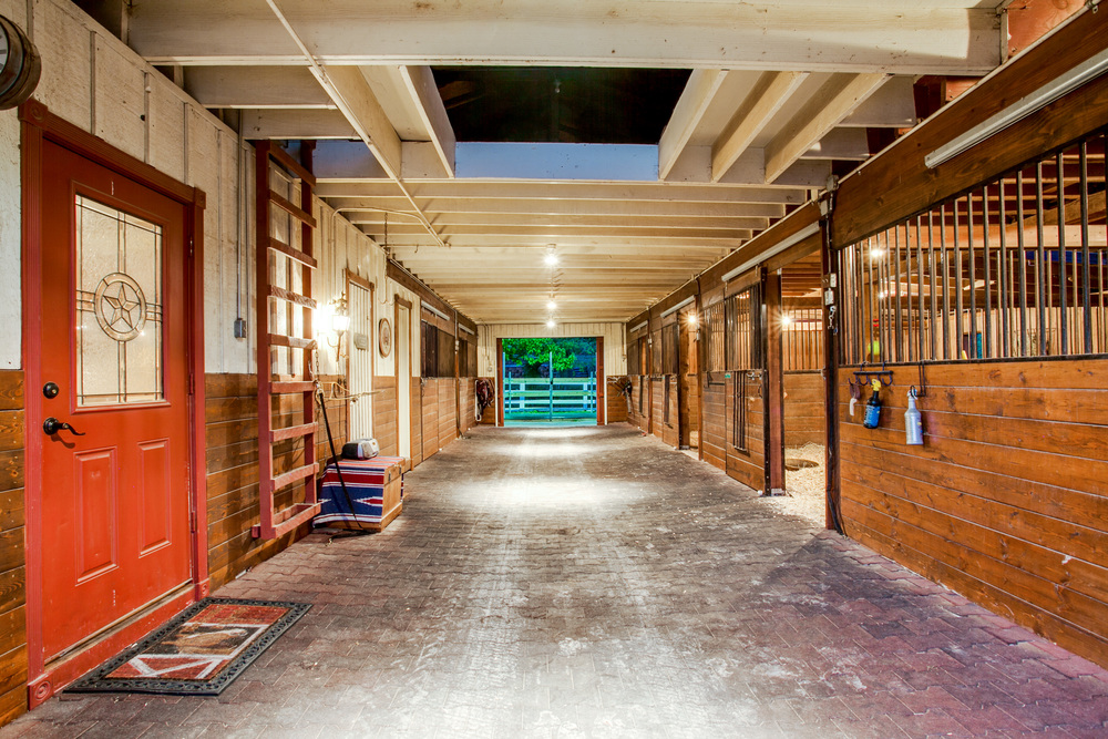 Inside-Stables-Lit-At-Night.jpg