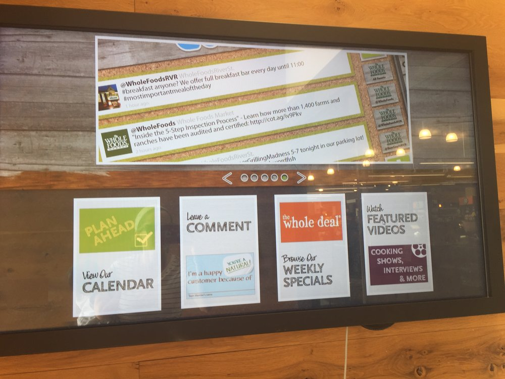 Digital board at entrance of store