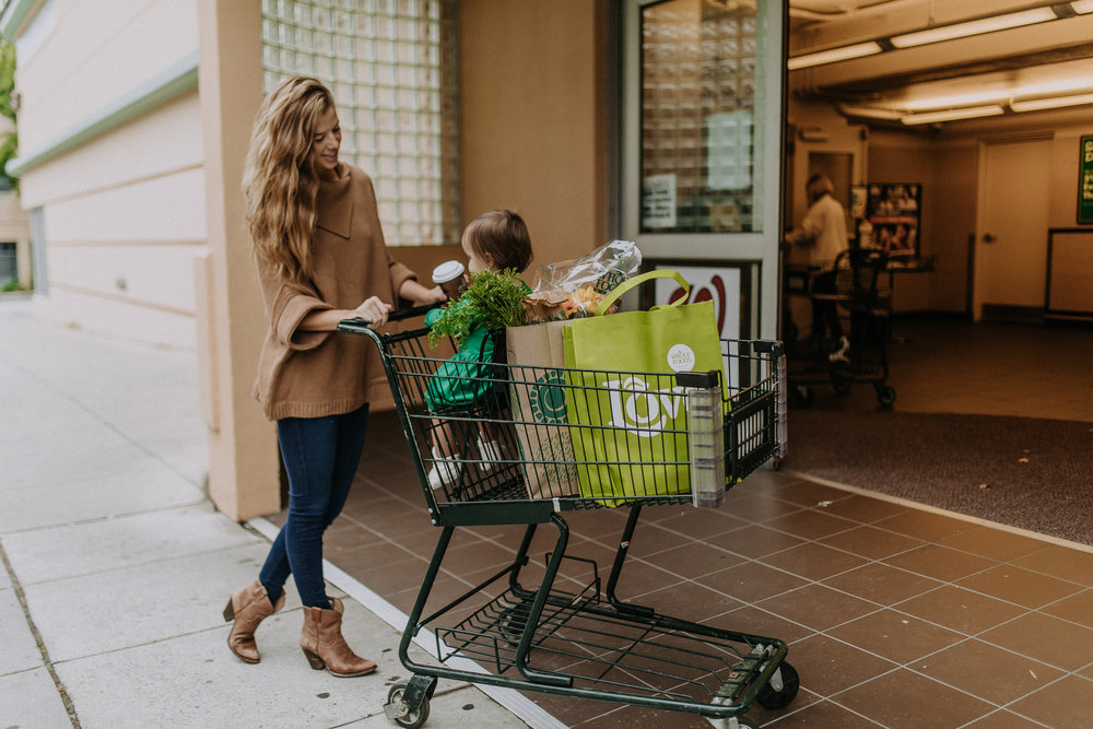 Mother and baby shopping for healthy groceries