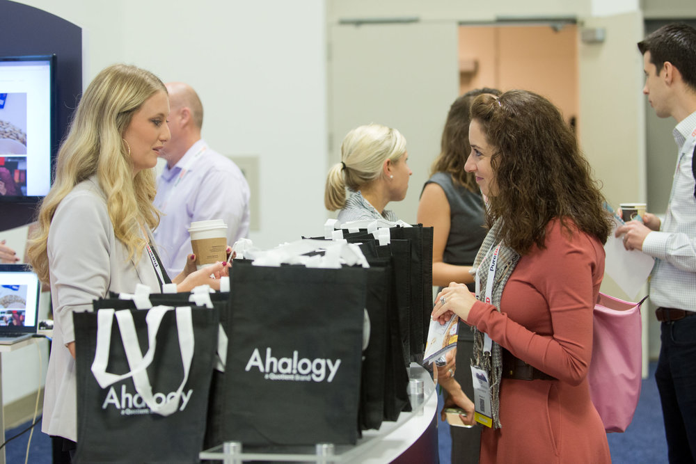 Lisa of Green Purse PR meeting with exhibitors at the show. Photo source: Path to Purchase Expo.