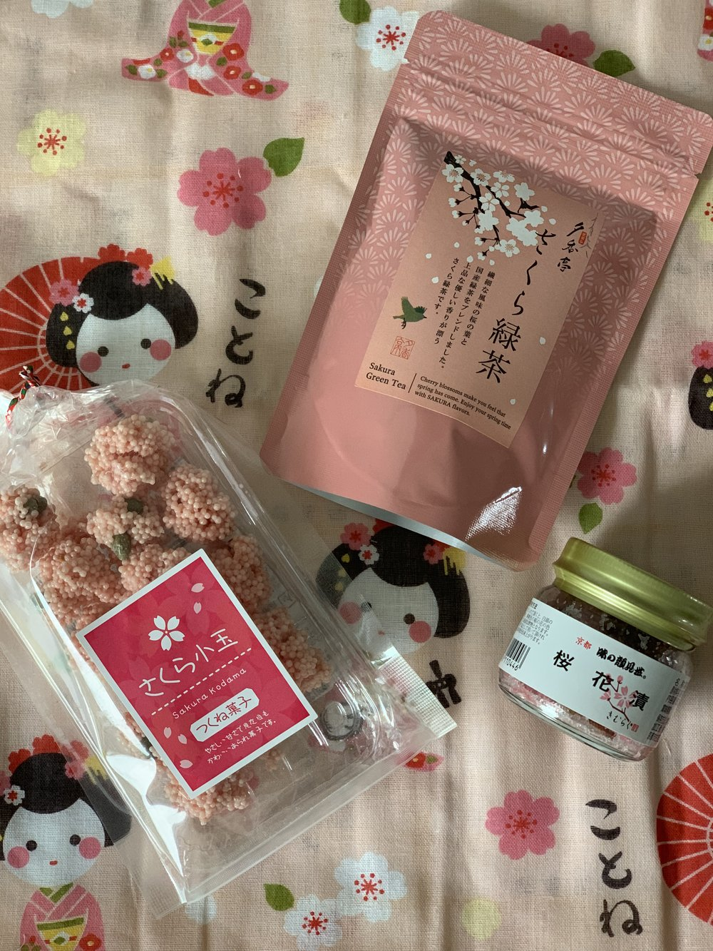 Sakura (cherry blossom) flavored treats (kind of like rice crispy treats,) loose leaf green tea, & sweet blossom flakes.