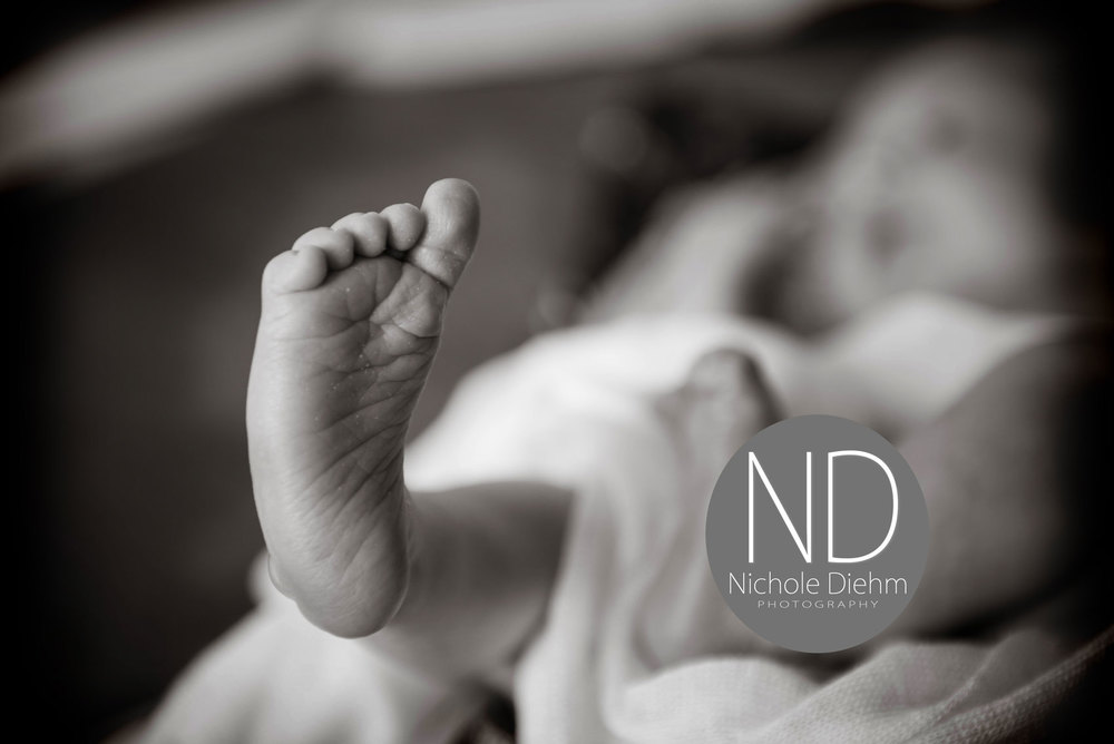 Newborn-Photography-black-white-foot--Cedar-Falls-Iowa.jpg