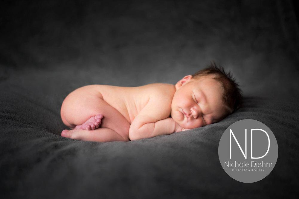 Newborn-Photography-gray-sleeping-boy-posey-pillow--Cedar-Falls-Iowa-.jpg
