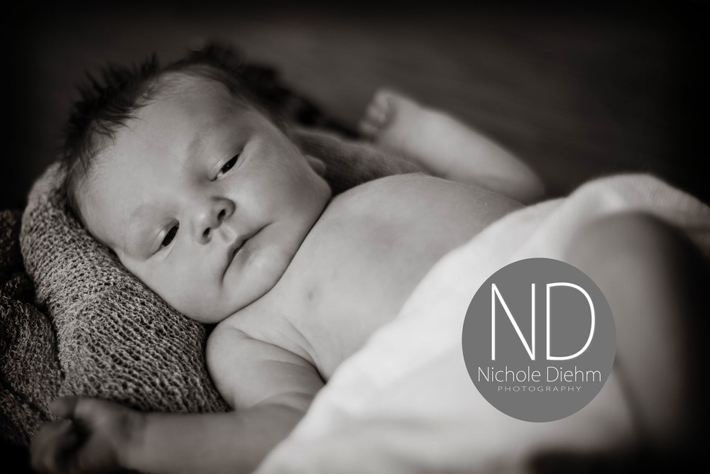 New-Born-Photography-wood-wicker-black-and-white-Cedar-Falls-Iowa.jpg
