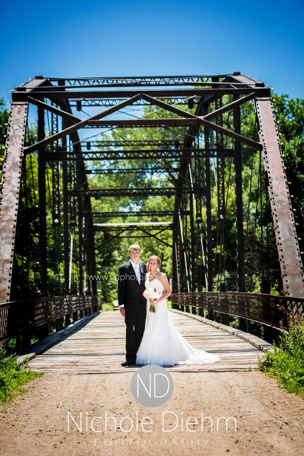 Brook-and-Stu-say-I-do-Cedar-Falls-Spencer-Iowa-Bridge-Smile.jpg