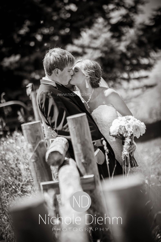 Brook-and-Stu-say-I-do-Cedar-Falls-Spencer-Iowa-field-kiss.jpg