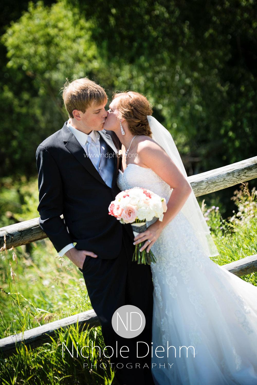 Brook-and-Stu-say-I-do-Cedar-Falls-Spencer-Iowa-field-kiss-2.jpg
