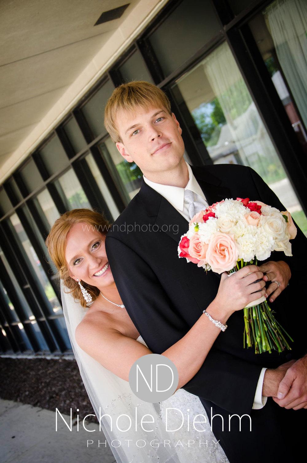 Brook-and-Stu-say-I-do-Cedar-Falls-Spencer-Iowa-first-look-2.jpg