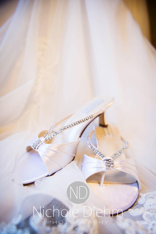 Brook-and-Stu-say-I-do-Cedar-Falls-Spencer-Iowa-natural-light-shoes-dress.jpg