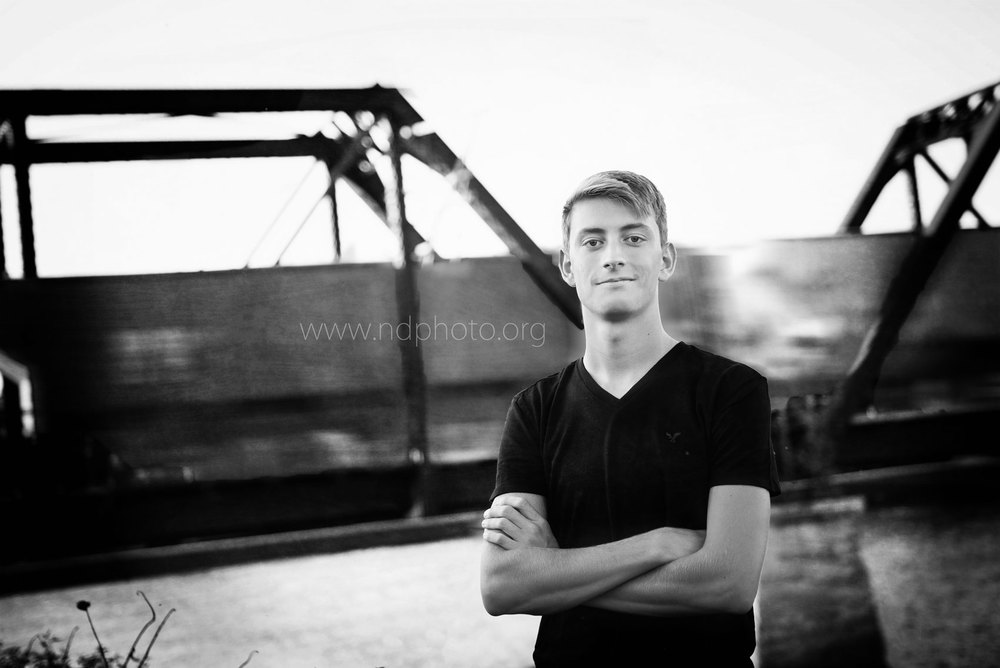 Senior-Photography-Cedar-Falls-Gus-Cedar-River-railroad-bridge-trainl.jpg
