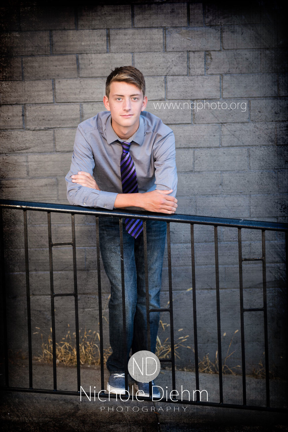 Senior-Photography-Cedar-Falls-Gus-tie-railing-ramp.jpg