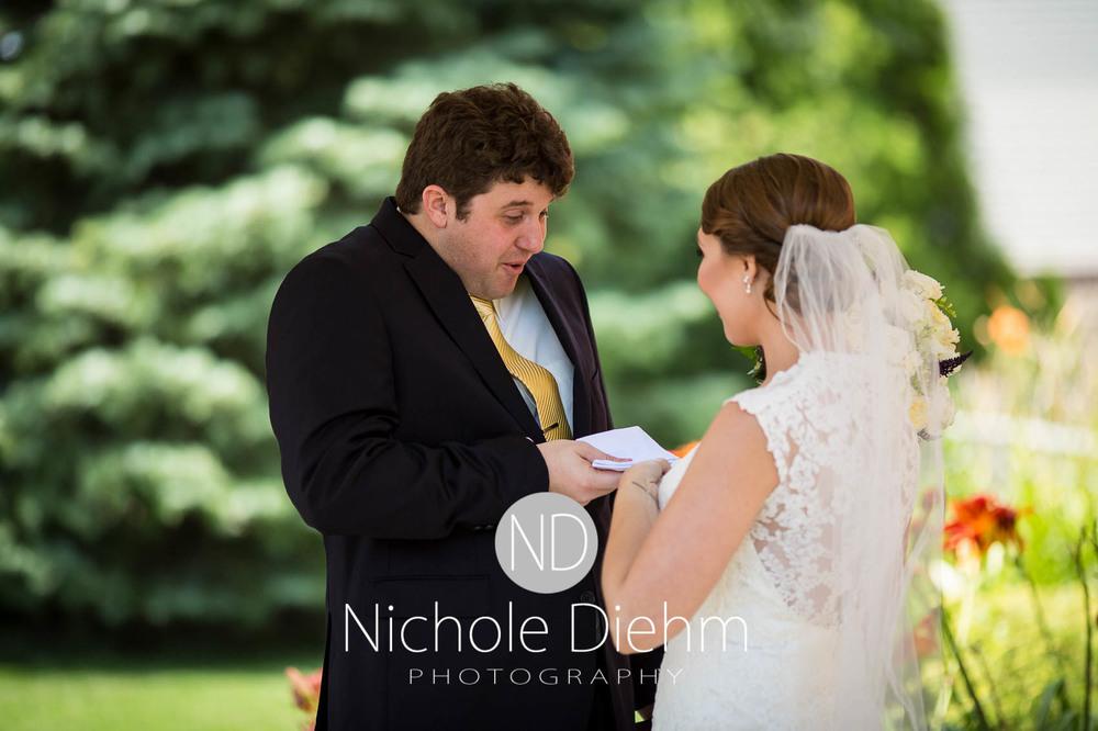 Katie-Schneider-Sam-Kelly-Wedding-Cedar-Falls-Iowa-Photographer-Nichole-Diehm-Photography-St.Stephens-Electric-Park-Ballroom-UNI233.jpg