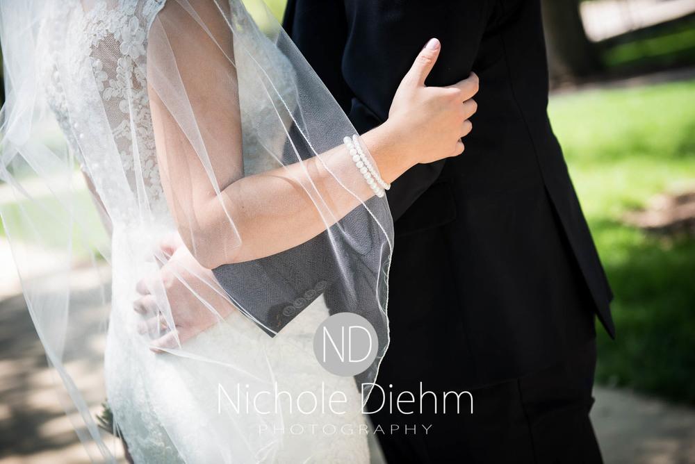 Katie-Schneider-Sam-Kelly-Wedding-Cedar-Falls-Iowa-Photographer-Nichole-Diehm-Photography-St.Stephens-Electric-Park-Ballroom-UNI477.jpg