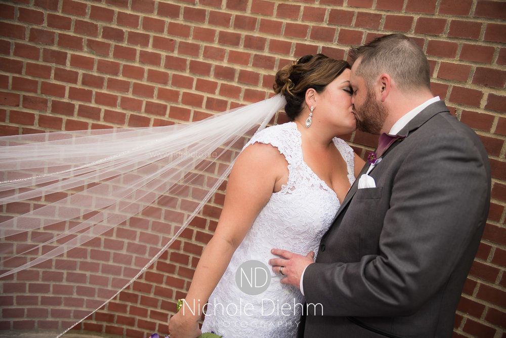 Cedar-Falls-Wedding-Photographer-John-Katie-Hilton-Garden-Inn-St-Eds-Church270.jpg
