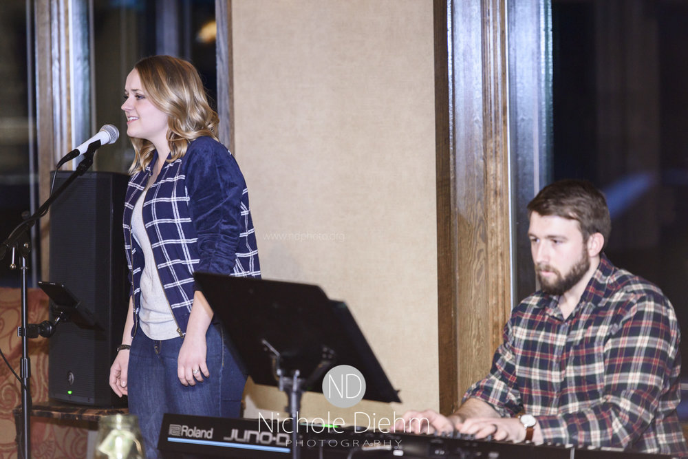 Hudson Road performing for the February 100+ Women who care Cedar Valley event at Beaver Hills Golf & Event Center