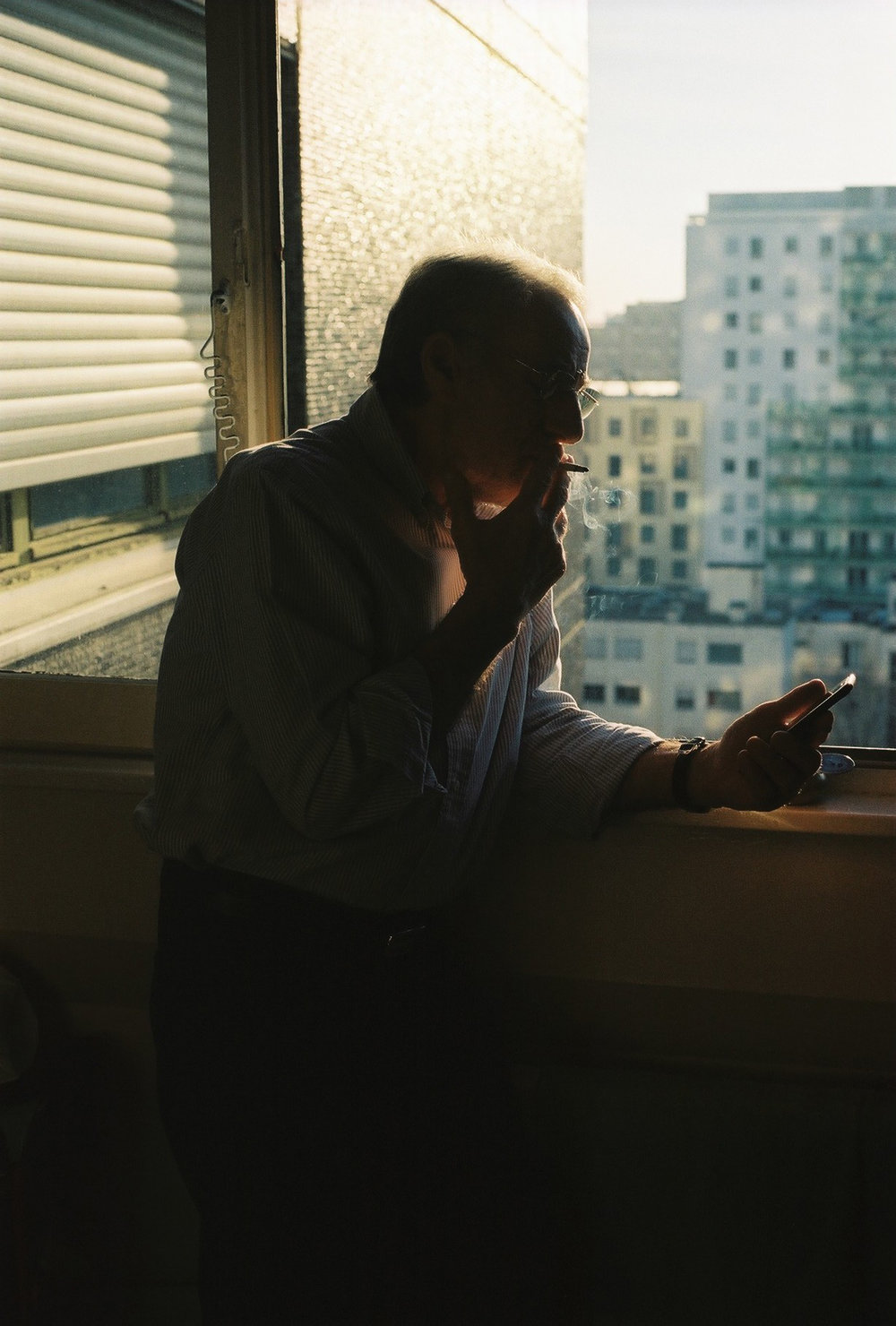 André at the kitchen window, Courbevoie, 2018