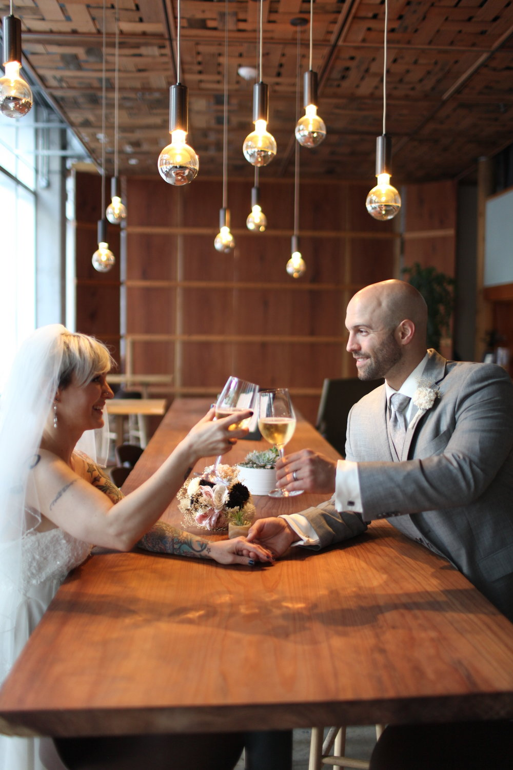 Couple toasting in bar _ Eliza Gregory.JPG