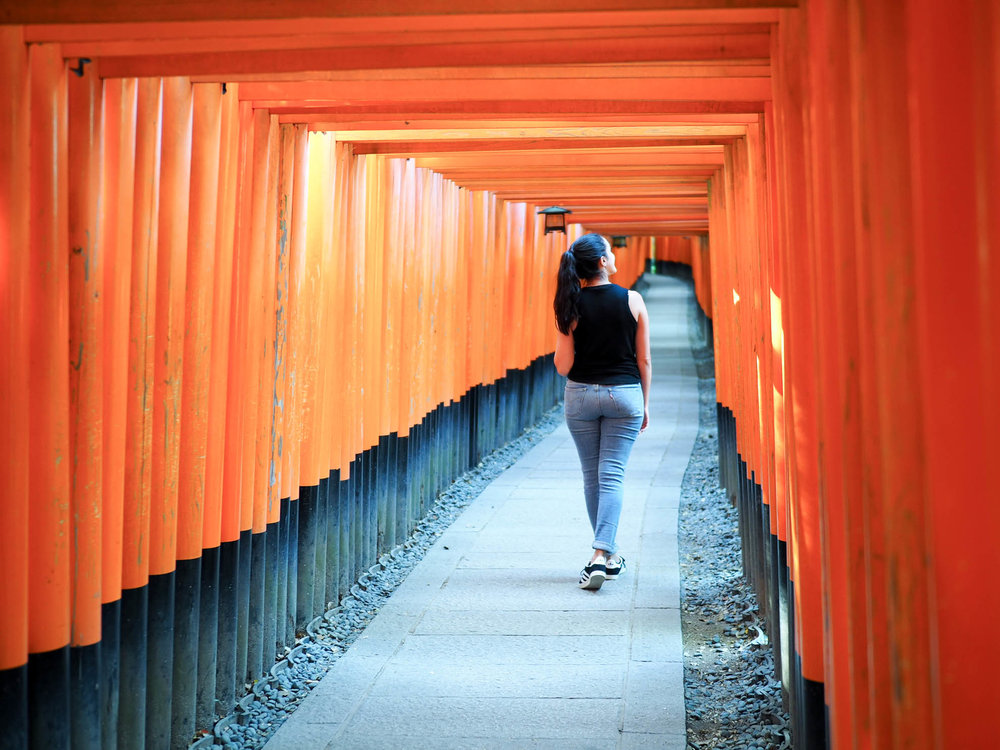 Early morning walk through the orange tori gates at Fushimi Inari Shrine in Kyoto, Japan.