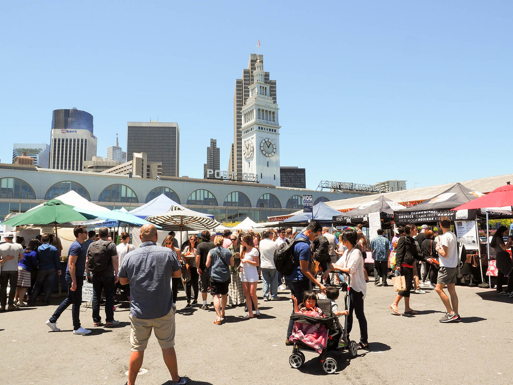 Busy Saturday morning at the Ferry Building Farmer's Market in San Francisco, California.