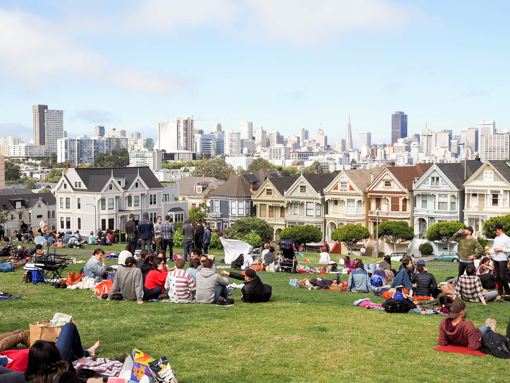 Alamo Square Park is a popular hangout spot for locals.