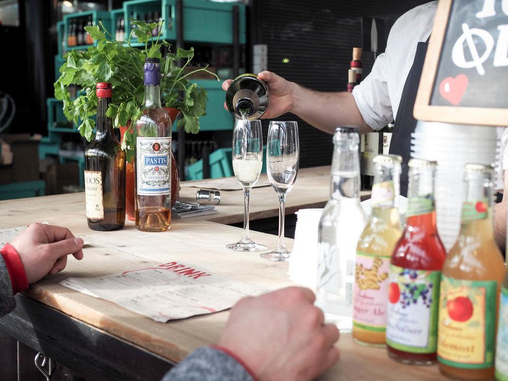 Have a drink at Le Petit in Torvehallerne Food Market in Copenhagen